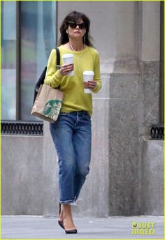 Katie Holmes wears a bright yellow sweater to add some sunshine to her day on a dreary and rainy morning on Tuesday (April 15) in New York City.
