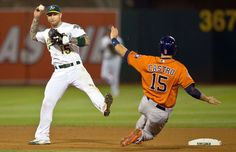 Slide and a kick -  Brett Lawrie of the Oakland Athletics completes a double play over Jason Castro of the Houston Astros Aug. 7 in Oakland, Calif. The Oakland Athletics 3-1. - © Jason O. Watson/Getty Images