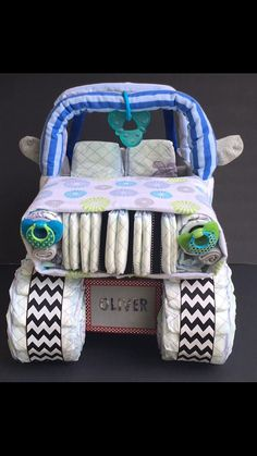 Do you have a Christmas or winter themed shower coming up?? We can theme this diaper cake to fit exactly what you are looking for!! Looking for a gift NO ONE else will have?? This diaper jeep is PERFECT for your next baby shower! Weather youre looking for a unique baby gift, or an awesome diaper centerpiece, this diaper cake is sure to be a crowd pleaser!! ****Each diaper cake is uniquely made. Variations may need to be made based on product availability. Please message me with color schemes…