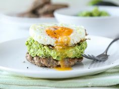 Tasty low-carb breakfast meal made with avocado, eggs and gluten-free sausage. Healthy eating doesn't have to be complicated!