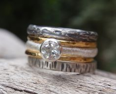 engagement ring wedding bands set in 14k solid yellow gold and sterling silver - set of 5 - handmade stacking rings - made to order. $275.00, via Etsy.