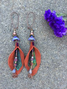 These are an original Zasra design. They are a ONE of a kind, handmade, boho, leather, art buddha dangle earrings. I have chosen a beautiful reclaimed