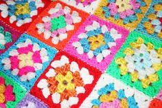 Multi coloured granny square babys blanket