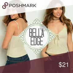 🆕 Beige lace up vneck tank top 💎62% POLYESTER, 34% RAYON, 4% SPANDEX 💎Made in USA 💎This v-neck tank top features spaghetti straps, ribbed stretch fabric and fashionable lace up detailing at chest. Looks great with jeans but also worn under a cardigan 💎Size small to large Bella Edge Boutique Tops Tank Tops