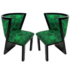 A Pair Of 30's French Art Deco Chairs In Ebonized Mahogany and new Malachite inspired textile upholstery.