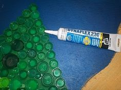 glue to use for bottle cap art  Also, I heard Weld Bond from Ace works really well