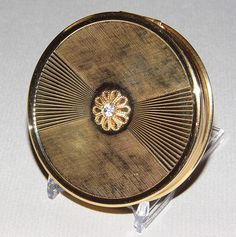 Vintage Max Factor Creme Puff Powder Compact, Goldtone with a Rhinestone in the Center, 2-7/8 Inches in Diameter.