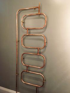Heated copper towel rail by Josh Shinner / Deko Modareji