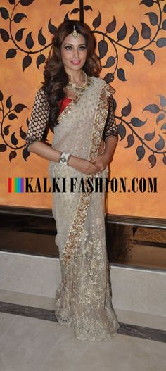Bipasha Basu in a cream and gold saree or sari and blouse by Vikram Phadnis.