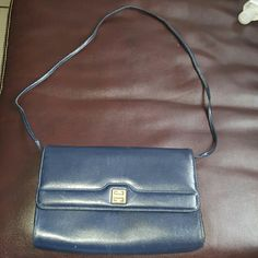 Vintage Givenchy clutch/shoulder bag Navy blue bag that can be used as a clutch or shoulder bag purchased at an estate sale so can't confirm authenticity some scratches on leather shown and wear on strap Givenchy Bags