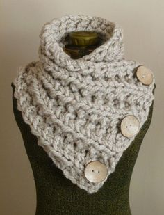 This hand knit chunky button scarf is made of soft and thick tan yarn. The yarn is doubled for extra warmth and the scarf is knit with intricate ribbing throughout the entire body of the scarf. There are three large functional coconut buttons hand sewn onto the scarf. This beautiful scarf wraps and buttons easily, and will keep you feeling warm and looking stylish. Size: Adult/Teen Finished unstretched measurements: Length 32 1/2 X Width 12 *** On sale now! Original price $68. Or...