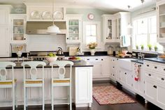 Love this vintage kitchen! Lighting, tile, farm house sink... Everything!