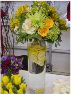 modern floral arrangements and centerpieces | Yellow Wedding Flower Arrangement with lemon.PNG