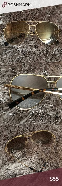 Michael Kors Sunglasses These Michael Kors sunglasses are in good pre-loved condition. The gold hardware and tortoise accents offer a stylish look that can be dressed up or down. Michael Kors Accessories Sunglasses