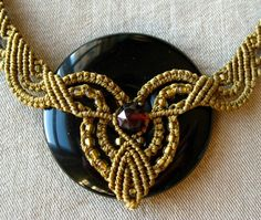 closeup of necklace medallion