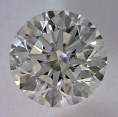 1.32-Carat Round Cut Diamond  This Excellent-cut J-color, and VS1-clarity diamond comes accompanied by a diamond grading report from GIA  $7273.86