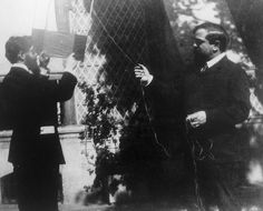 Claude Debussy (R) preparing to fly a kite with a friend.