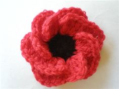"""Hope Blooms Poppy by Jenny King, Interweave Crochet Summer 2014  Our latest issue, Summer 2014, features a moving article about Samantha Nerove, a soldier who crochets to keep positive in such a chaotic environment. Samantha loves to crochet flowers for others, and in her words """"hand over a piece of sunshine"""". To find a …"""