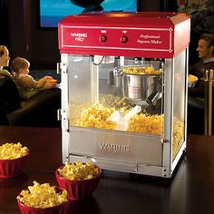 I haven't had popcorn with real butter since I was a kid! My mom used to have an air popper with a little attached dish that melted the butter as the hot air passed by it. I wonder if they even make those any more?