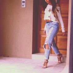 Love the ripped jeans and heels. That top needs to go