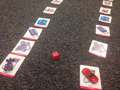 Using Articulation Cards in Therapy. Line the cards up in rows on the floor like a game board, choose game pieces, and roll a die to move your piece until one person reaches the designated finish line.