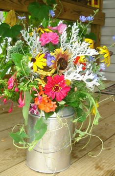 Lovely fresh-cut flower garden arrangement in an old tin milk jug - this is a photo of one I did last summer from my annual & perennial gardens.  Lovely on a kitchen table or as a gift.