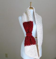 Bow Infinity Scarf. Just add in some red and tie it off when done knitting on round... easy enough.