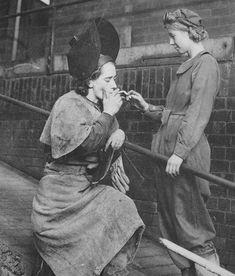 Woman industrial workers taking a smoke break. UK? WWII?
