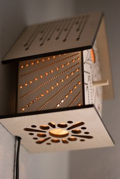 This little wooden birdhouse has been fitted with a low-wattage candelabra bulb and laser cut with a playful starburst pattern. Its glow is soft and warm, making it perfect for a nursery or kids room nightlight, or an interesting addition to any other space.  This lamp can be displayed standing on a surface, such as a shelf or dresser, or it can be hung on the wall. The light has two different configurations to best suit your needs and can transition easily from one to the other