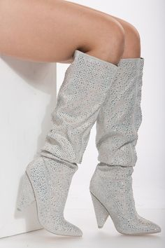 Silver Rhinestone Slouch Knee High Boots These are so in right now and are definitely a fashion statement! They feature a faux leather material, slouchy detail, rhinestone embellishment, and chunky heel! - True to size (sizing may vary based on foot width)