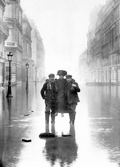 Flood in Paris 1910 - Men helping a woman on an almost deserted street during the flood which lasted a week