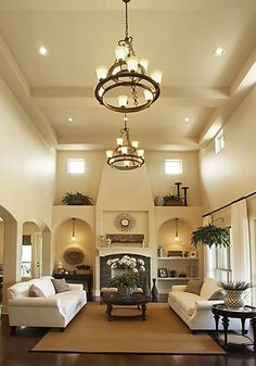 High ceilings. Sophisticated Rustic. Living Room. though, not a huge fan of the light fixtures.