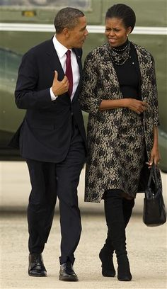 President Obama talks with First Lady Obama as they walk to Air Force One at Andrews Air Force Base, Maryland on November 11, 2011, for a trip to Hawaii, Australia and Indonesia.