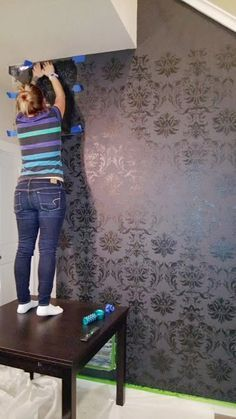 Stenciling a DIY accent wall using the Gabrielle Damask Stencil from Cutting Edge Stencils. http://www.cuttingedgestencils.com/damask-stencil-3.html