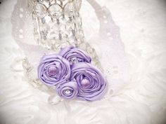 A personal favorite from my Etsy shop https://www.etsy.com/listing/192982657/lavender-light-purple-fabric-rosette
