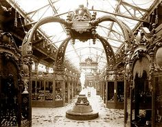 "Exhibits in the Palace of Diverse Industries, Sign above exhibits: ""Maroquinerie–Gainerie."" Paris World Fair c. 1889"