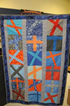 My first wonky cross quilt made by 5th grade class. Each student designed their cross.
