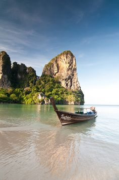 The early morning sun bathes the karst (rock formation) behind a long-tail boat at Railay West Beach in Krabi, Thailand. Places Around The World, Oh The Places You'll Go, Cool Places To Visit, Places To Travel, Playa Railay, Railay Beach, Bangkok, Khao Lak Beach, Places