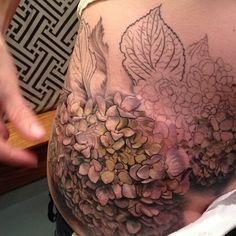 Exquisite hydrangea tattoo in progress by Esther Garcia.