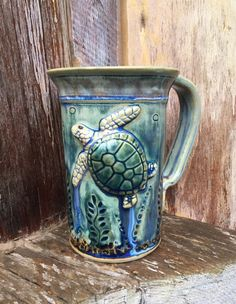 Green Sea Turtle Mug by ClayFantaSea on Etsy https://www.etsy.com/listing/260313781/green-sea-turtle-mug