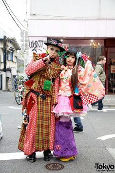 06d3e6b3884fd Two Harajuku girls wearing handmade outfits featuring elements of traditional  Japanese fashion mixed with modern punk and gothic influences.