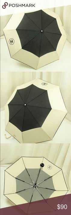 "New Chanel Black and Beige Nylon Camellia Umbrella ️New Never Used. High quality. Not orig.  Auto Open Close Chanel stylish black and beige nylon umbrella in Chanel box  The chic umbrella comes with a quilted nylon carrying case on a silver metal chain strap.   Measurements  The diameter measures 38.5 inches open from point to point The chrome metal handle measures 20"" inches in length CHANEL Accessories Umbrellas"