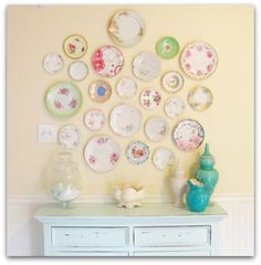 plate wall - hobby lobby has the plate hangers i want.