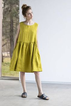 PLEASE KEEP in mind that the dress is of loose fit (designed specially that it can be used as jumper also for other clothes to wear underneath), if you do not want a loose fit look, you should go one size down. Washed and soft greenish mustard linen loose dress for simple and casual