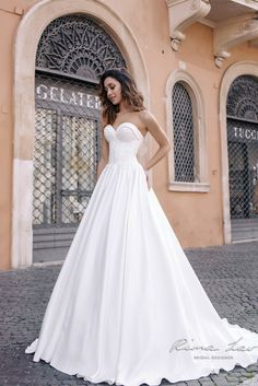 The Aline style, strapless bodice, cord lace on the corset, and unusual neckline embellishment make this dress unique and stylish. Modest Wedding Dresses, Elegant Wedding Dress, Unique Dresses, Bridal Dresses, Beautiful Dresses, Bridesmaid Dresses, Happy Bride, Bridal Collection, Bridal Style