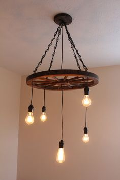 Vintage Industrial Wagon Wheel Chandelier by UEvrWndrY on Etsy, $249.00