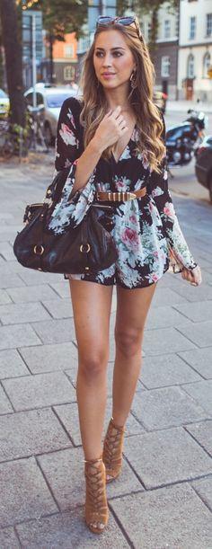 Kenza Zouiten is wearing a floral playsuit with suede heels.  Playsuit: Reverse, Shoes: River Island