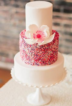 Brides: Sprinkle Wedding Cake with Alternating White and Rainbow Tiers and Flower Adornment. Is a sprinkle-smothered cake too much for your soirée? Keep the color confined to just one tier, like on this treat from Sweet Art Bakeshop. Sprinkle Wedding Cakes, Sparkly Wedding Cakes, Beautiful Wedding Cakes, Gorgeous Cakes, Pretty Cakes, Cute Cakes, Amazing Cakes, Sprinkle Cakes, Sparkly Cake