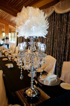 Old Hollywood wedding centerpiece- love the idea of a sexy candelabra as a part of the centerpiece
