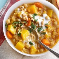 Pumpkin, Chickpea, and Red Lentil Stew  Brimming with seasonal pumpkin and carrots, this tomato-base stew makes a delicious cold-weather supper. Lentils and beans pack filling protein, while nonfat yogurt adds creaminess without the fat.